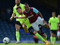 Dimitri Payet of West Ham United battles with Cian Bloger of Southend United during the pre season friendly match between Southend United and West Ham United at Roots Hall on July 18, 2015