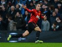 Manchester United's Dutch striker Robin Van Persie celebrates scoring his late winning goal in the English Premier League football match between Manchester City and Manchester United at The Etihad stadium in Manchester, north-west England on December 9, 2