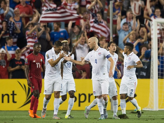 Michael Bradley (4) of the United States celebrates a goal with United States teammates during the CONCACAF Gold Cup match between Panama and United States at Sporting Park in Kansas City, Kansas on July 13, 2015