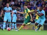 Ricky Van Wolfswinkel of Norwich City battles with Daniel Henry of West Ham United during the pre season friendly match between Norwich City and West Ham Un
