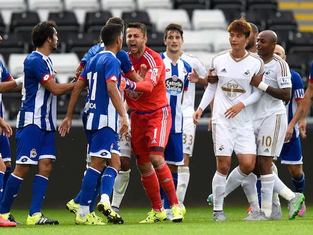 Swansea goalkeeper Lukasz Fabianski (red shirt) gets involved in a fracas during the Pre season friendly match between Swansea City and Deportivo La Coruna at Liberty Stadium on August 1, 2015