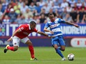 Tiaronn Chery of Queens Park Rangers breaks away from Ahmed Kashi of Charlton Athletic during the Sky Bet Championship match between Charlton Athletic and Queens Park Rangers at The Valley on August 8, 2015