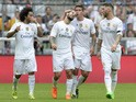 Real Madrid's Brazilian defender Marcelo, Real Madrid's midfielder Isco, Real Madrid's Columbian midfielder James and Real Madrid's defender Sergio Ramos celebrates scoring during the Audi Cup football match Real Madrid vs Tottenham Hotspur in Munich, sou