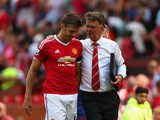 Michael Carrick of Manchester United walks with Louis van Gaal Manager of Manchester United after the Barclays Premier League match between Manchester United and Tottenham Hotspur at Old Trafford on August 8, 2015