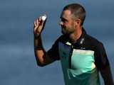 Troy Merritt acknowledges the crowd and holds up his ball after winning the Quicken Loans National at the Robert Trent Jones Golf Club on August 2, 2015