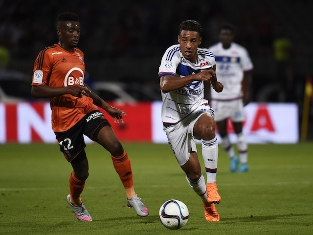 Lyon's French midfielder Corentin Tolisso (R) vies with Lorient's Cameroonian forward Benjamin Moukandjo (L) during the French Ligue1 football match between Olympique Lyonnais and FC Lorient on August 9, 2015
