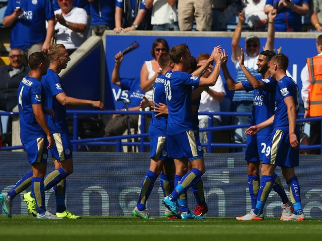 Riyad Mahrez of Leicester City celebrates scoring his team's second goal with his team mates during the Barclays Premier League match between Leicester City and Sunderland at The King Power Stadium on August 8, 2015