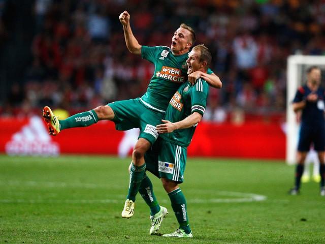 Christopher Dibon and Mario Sonnleitner of Rapid Wien celebrate after victory in the third qualifying round 2nd leg UEFA Champions League match between Ajax Amsterdam and SK Rapid Vienna held at Amsterdam ArenA on August 4, 2015