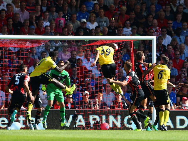 Rudy Gestede (C) of Aston Villa scores his team's first goal with his team mate Carlos Sanchez (R) during the Barclays Premier League match between A.F.C. Bournemouth and Aston Villa at Vitality Stadium on August 8, 2015