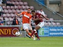 Dominic Calvert-Lewin of Northampton Town shoots to score his sides 2nd goal during the Capital One Cup First Round match between Northampton Town and Blackpool at Sixfields Stdium on August 11, 2015
