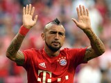 Bayern Munich's Chilean midfielder Arturo Vidal waves prior to the German first division Bundesliga football match FC Bayern Munich vs Hamburger SV at the Allianz Arena in Munich, southern Germany, on August 14, 2015
