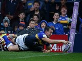 Danny McGuire of Leeds Rhinos scores a try during the Round 2 match of the First Utility Super League Super 8s between Leeds Rhinos and Wigan Warriors at Headingley Carnegie Stadium on August 14, 2015