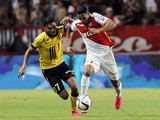 Lille's French midfielder Sofiane Boufal vies for the ball with Monaco's Moroccan midfielder Nabil Dirar (R) during the French L1 football match between Monaco and Lille on August 14, 2015