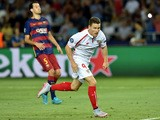 Sevilla's French forward Kevin Gameiro celebrates after scoring a goal during the UEFA Super Cup final football match between FC Barcelona and Sevilla FC in Tbilisi on August 11, 2015