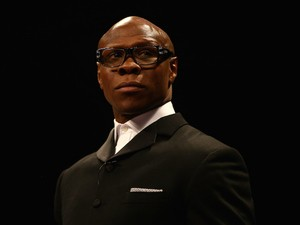 Chris Eubank looks on before his son Chris Eubank Jnr fights Dmitry Chudinov for the WBA Interim World Middleweight Championship at the O2 Arena on February 28, 2015 in London, England.