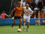 Wolves' Dave Edwards is pursued by Michael Dawson of Hull on August 16, 2015