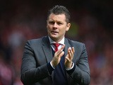 Manager Steve Cotterill of Bristol City applauds the crowd as he walks out for the Sky Bet League One match between Bristol City and Walsall at Ashton Gate on May 3, 2015
