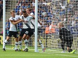 Dele Alli of Tottenham Hotspur celebrates scoring his team's first goal with his team mates Tom Carroll and Harry Kane during the Barclays Premier League match between Leicester City and Tottenham Hotspur at The King Power Stadium on August 22, 2015