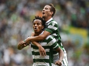 Sporting's Peruvian forward Andre Carrillo (L) celebrates with his teammate Sporting's defender Joao Pereira (R) after scoring against Pacos de Ferreira during the Portuguese league football match Sporting CP vs FC Pacos de Ferreira at the Jose Alvalade s