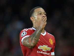Manchester United's Dutch midfielder Memphis Depay celebrates after scoring his team's second goal during the UEFA Champions League play off football match between Manchester United and Club Brugge at Old Trafford in Manchester, north west England, on Aug