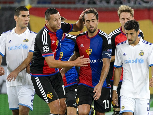Basel's Czech defender Marek Suchy congratulates his teammate Argentinian midfielder Matias Delgado after he score a penalty during the UEFA Champions League playoff football match between FC Basel and Maccabi Tel Aviv at the St Jakob Park stadium in Base