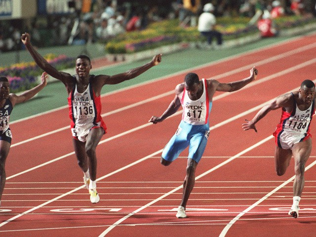 US sprinter Carl Lewis (2nd L) celebrates after winning the 100m final in a world record time of 9.86 sec at the World Athletics Championships, 25 August 1991