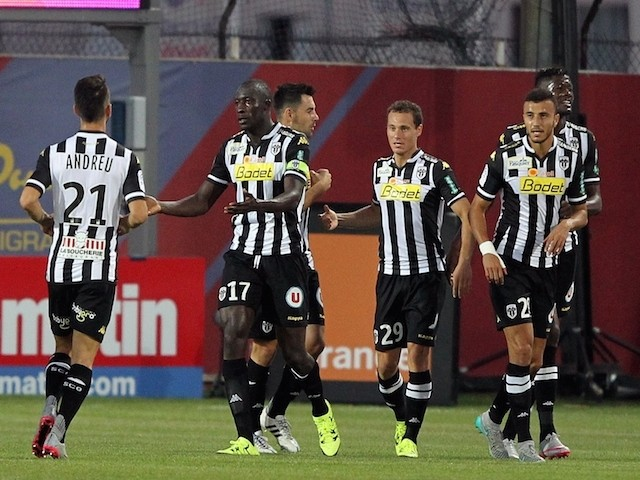 Angers' Senegalese midfielder Cheikh N'Doye (C) is congratulated by teammates after scoring a goal during the French L1 football match GFC Ajaccio (GFCA) against Angers (SCO) on August 22, 2015