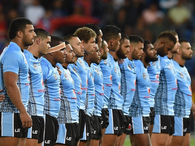 Players of Fiji stand during the national anthem before the International Test Match between TOA Samoa and Tonga at Cbus Super Stadium on May 2, 2015