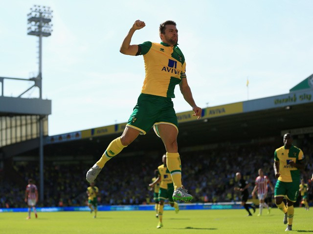 Russel Martin of Norwich City celebrates scoring his team's first goal during the Barclays Premier League match between Norwich City and Stoke City at Carrow Road on August 22, 2015