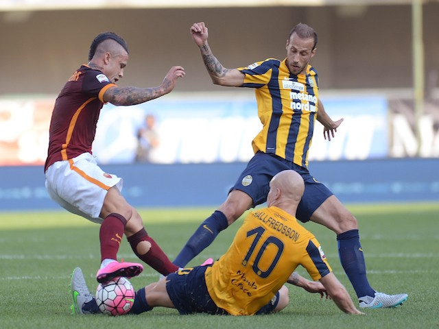 Radja Nainggolan (L) of AS Roma battles for the ball with Emil Hallfredsson #10 and Evangelos Moras of Hellas Verona during the Serie A match between Hellas Verona FC and AS Roma at Stadio Marc'Antonio Bentegodi on August 22, 2015