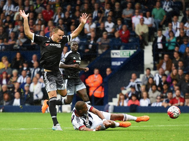 John Terry of Chelsea challenges Salomon Rondon of West Bromwich Albion leading to his red card during the Barclays Premier League match between West Bromwich Albion and Chelsea at The Hawthorns on August 23, 2015