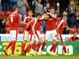 Marley Watkins of Barnsley is congratulated by team mates after scoring his team's second goal during the Capital One Cup second round match between Barnsley and Everton at Oakwell Stadium on August 26, 2015 in Barnsley, England.