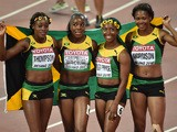 Jamaica's Elaine Thompson, Jamaica's Shelly-Ann Fraser-Pryce, Jamaica's Veronica Campbell-Brown and Jamaica's Natasha Morrison pose after winning the final of the women's 4x100 metres relay athletics event at the 2015 IAAF World Championships at the 'Bird