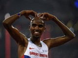 Britain's Mo Farah celebrates with a 'mobot' pose after winning the final of the men's 5000 metres athletics event at the 2015 IAAF World Championships at the 'Bird's Nest' National Stadium in Beijing on August 29, 2015
