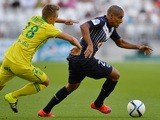 Bordeaux's French-born Tunisian midfielder Wahbi Khazri (R) vies with Nantes' French midfielder Valentin Rongier (L) during the French Ligue 1 football match between Bordeaux (FCGB) and Nantes on August 30, 2015