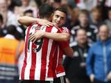 Southampton's Serbian midfielder Dusan Tadic celebrates with Southampton's Italian striker Graziano Pelle (L) after scoring their third