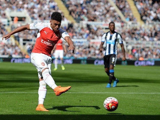 Arsenal's English midfielder Alex Oxlade-Chamberlain takes the shot which deflects off Newcastle United's Argentinian defender Fabricio Coloccini (not pictured) for Arsenal's opening goal in the English Premier League football match between Newcastle Unit
