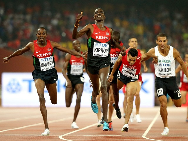 Asbel Kiprop of Kenya crosses the finish line to win gold in the Men's 1500 metres final ahead of Elijah Motonei Manangoi of Kenya and Abdalaati Iguider of Morocco during day nine of the 15th IAAF World Athletics Championships Beijing 2015 at Beijing Nati