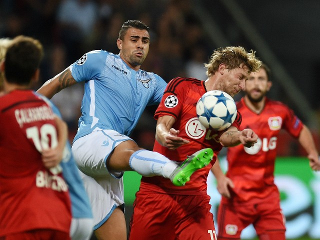 Leverkusen's forward Stefan Kiessling (R) and Lazio's defender from Brazil Mauricio vie for the ball during the UEFA Champions League playoff football match between Bayer Leverkusen and SS Lazio, in Leverkusen, western Germany, on August 26