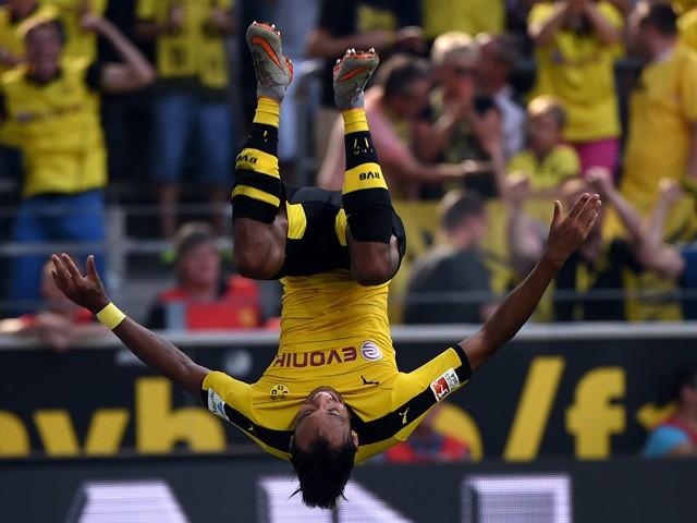 Dortmund's Gabonese striker Pierre-Emerick Aubameyang makes a jump after scoring during the German first division Bundesliga football match Borussia Dortmund vs Hertha BSC in Dortmund, Germany, on August 30, 2015