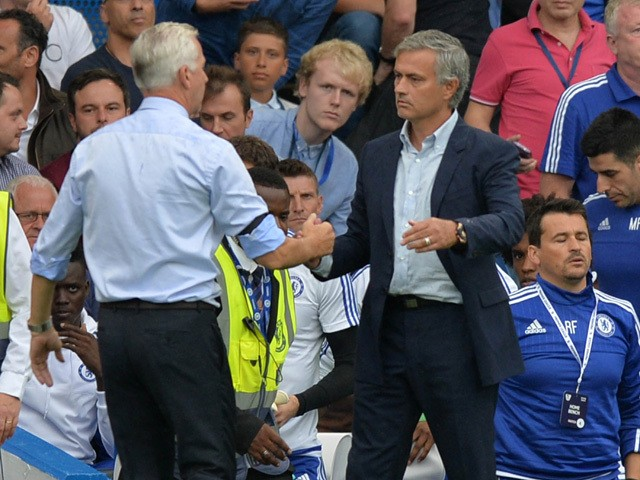 Crystal Palace's English manager Alan Pardew shakes hands with Chelsea's Portuguese manager Jose Mourinho after the English Premier League football match between Chelsea and Crystal Palace at Stamford Bridge in London on August 29, 2015