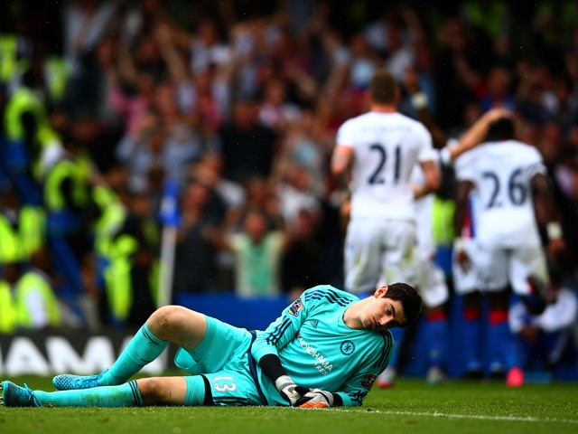 Thibaut Courtois of Chelsea reacts after conceding Crystal Palace's first goal during the Barclays Premier League match between Chelsea and Crystal Palace at Stamford Bridge on August 29, 2015