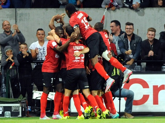 Guingamp's players celebrate after scoring a goal during the French L1 football match between Guingamp (EAG) and Marseille (OM) on August 28, 2015