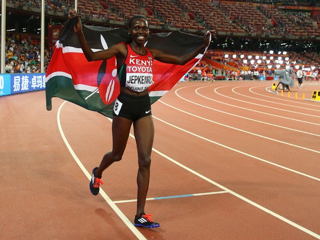 Hyvin Kiyeng Jepkemoi of Kenya celebrates after crossing the finish line to win gold in the Women's 3000 metres steeplechase final during day five of the 15th IAAF World Athletics Championships Beijing 2015 at Beijing National Stadium on August 26, 2015