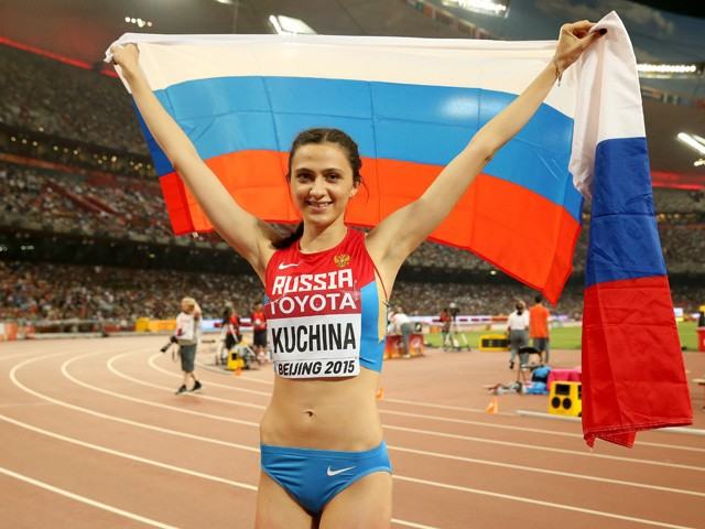 Maria Kuchina of Russia celebrates after winning gold in the Women's High Jump final during day eight of the 15th IAAF World Athletics Championships Beijing 2015 at Beijing National Stadium on August 29, 2015