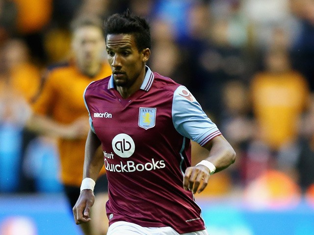 Scott Sinclair of Aston Villa runs with the ball during the pre season friendly between Wolverhampton Wanderers and Aston Villa at Molineux on July 28, 2015