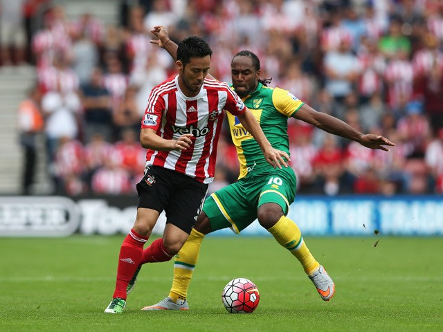Maya Yoshida of Southampton is closed down by Cameron Jerome of Norwich City during the Barclays Premier League match between Southampton and Norwich City at St Mary's Stadium on August 30, 2015