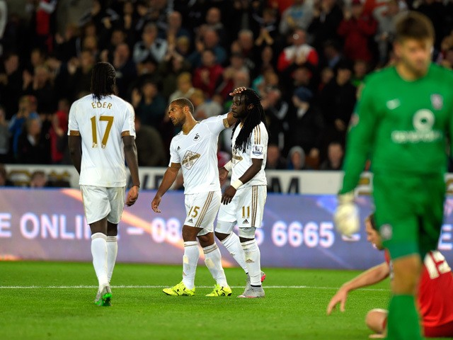 Swansea player Marvin Emnes is congratulated after scoring the third goal during the Capital One Cup Second Round match between Swansea City and York City at Liberty Stadium on August 25, 2015