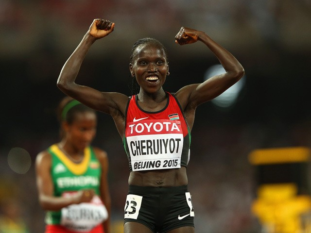 Vivian Jepkemoi Cheruiyot of Kenya crosses the finish line to win gold in the Women's 10000 metres final during day three of the 15th IAAF World Athletics Championships Beijing 2015 at Beijing National Stadium on August 24, 2015