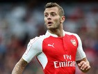 Jack Wilshere of Arsenal looks on during the Emirates Cup match between Arsenal and VfL Wolfsburg at the Emirates Stadium on July 26, 2015